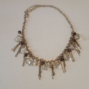 Women's gold necklace with clear and brown gems